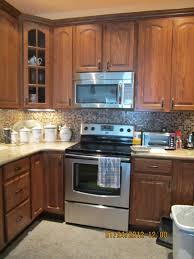 ah ha my exact color cabinet american woodmark oak tawny new