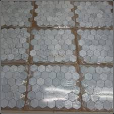carrara marble look ceramic tile floor tiles home design ideas