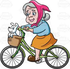 A Female Senior Citizen Enjoying Bike Ride With Her Dog