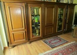 wohnzimmerschrank eiche rustikal massiv mit vitrinen
