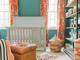 blue and orange nursery with orange curtains transitional