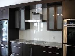 Light Blue Glass Subway Tile Backsplash by Quartz Countertops Kitchen Cabinets With Glass Doors Lighting