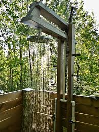 A TOUCH OF LUXURY An Outdoor Shower Doesnt Have To Be So Rustic This One Has Hot And Cold Running Water Rain Style Showerhead