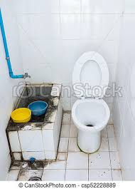 Dirty Public Toilet With The White Tile