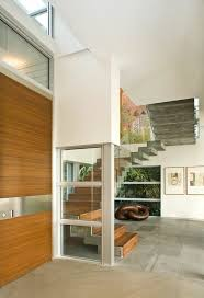 This Breezy Entrance Features A Floating Stairway To Make Striking Statement All The Glass Modern