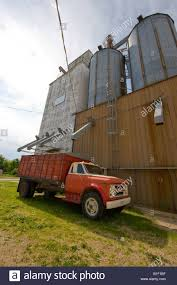 A Grain Trucks Sits At An Elevator In A Small Illinois Town Stock ... Grain Trucks 4x4 2017 Dodge Charger Ca Farm Truck Jhe Auctions Ford F600 Grain Truck V10 Fs17 Farming Simulator 17 Mod Fs Cabover 1966 Chevrolet Coe 60 Grain Truck My Kamaz Presents New Carrier Peterbilt 379 For 2015 15 1981 Gmc 7000 For Sale 3647 Miles Hale Center Intertional Loadstar V12 1980 C70 Tandem Dickinson Equipment 2005 Heavy Duty
