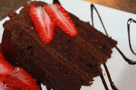 Triple layer chocolate cake with a few sweet strawberries makes a delicious Valentine s day treat