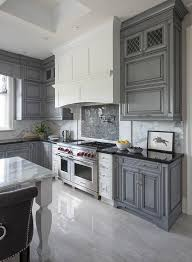 White And Gray Kitchen Features Wash Cabinets Paired With Black Granite Countertops A