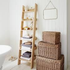Coastal Bathroom Wall Decor by Rustic Ladder Shelving Idea Beside Rattan Wicker Case In Coastal