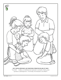 A Family Kneeling In Prayer