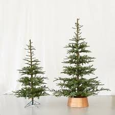 Neuman Christmas Tree Retailers by Snowy Faux Noble Fir Firs Holidays And Christmas Tree