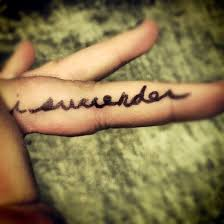 Surrender Tattoo On Fingers