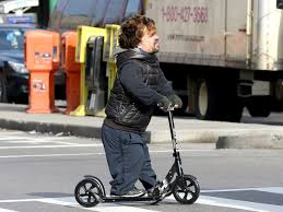 Peter Dinklage Riding A Razor Scooter