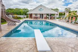 In Ground Swimming Pool With House Slide Diving Board Royalty