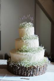 Wedding Cake With Babys Breath At This Southern Spring Barn Event Center