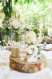 The Best Of Everything Flowers A Wooden Disc Bottles Lace And Burlap Rustic Centerpieces