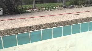 caulk above pool tile