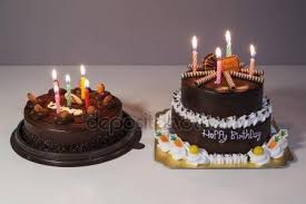 Chocolate cake with happy birthday light candle Royalty Free Stock s