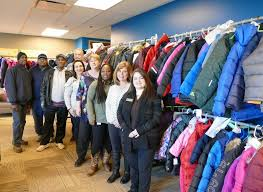 Pivotal Home Solutions donates over 125 coats to Aurora youth