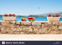 Family Vacation Concept. Brightly Coloured Kids Toy Trucks With Sea ...