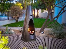 Stylish Indoor Outdoor Fireplaces That Warm Up Any Setting
