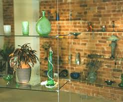 suspended glass shelving systems for retail business and