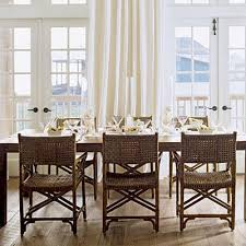 Coastal Dining Room With Wicker Chairs