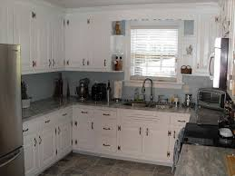small subway tiles and warm gray grey granite countertops