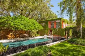 2 Acre Lot In Miamis Ponce Davis Neighborhood Holds A Five Bedroom Main House And Four Outbuildings Which Include An Art Studio Yoga Space