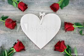 Rustic Wooden Heart And Red Roses Over Background For Valentines Day Holiday With Copy Space