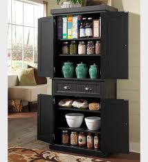 rustic black wooden kitchen pantry cabinet set with brown rug near