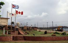 In This June 22 2011 Photo A Canadian Flag Flies Alongside The Cuban