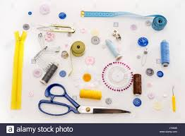 Top view of sewing kit and set of sewing supplies isolated on grey