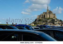 busy car park at mont michel normandy stock photo