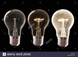 three l bulb halogen with different luminosity against black