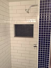large subway tile bathroom transitional with grey bathtub surround
