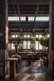 Restaurant And Bar With Brick Walls High Exposed Ceiling Sky Lights