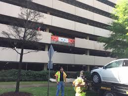 uab parking deck 4 uninjured after car rolls parking deck in downtown
