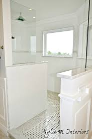 walk in shower with basket weave mosaic marble tile floor and glass