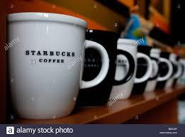 Black And White Starbucks Coffee Mugs In A Row On Shelf Stuttgart Baden