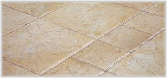 remove tile from concrete floor without breaking tiles home