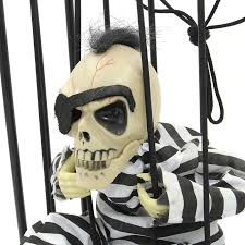 Motion Sensor Halloween Decorations by Motion Sensor Hanging Caged Animated Mohawk Eye Patch Jail