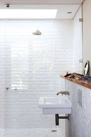 bathroom shower and white tile bathroom plus floating sink will