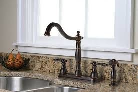 Charlestown Two Handle Kitchen Faucet With Matching Side Spray Parisian Bronze
