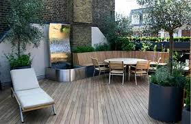 Inexpensive Patio Floor Ideas by Patio Concrete Cheap Patio Floor Ideas With Black Rattan Chairs
