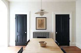 Black Interior Doors In Dining Room With Stained Trim