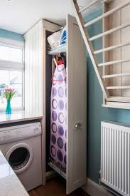 Ironing Board Cabinet Ikea by Best 25 Ironing Board Storage Ideas On Pinterest Laundry Closet