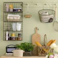 Wire Mesh Shelves Covered With Mugs Small Jars And Boxes Of Cookies On