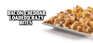 A Family Size Version Of Our Crazy Bites Loaded With Bacon And Melted Cheese Plus Side Jalapenos