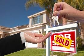 Handing Over The House Keys In Front Of A Beautiful New Home
